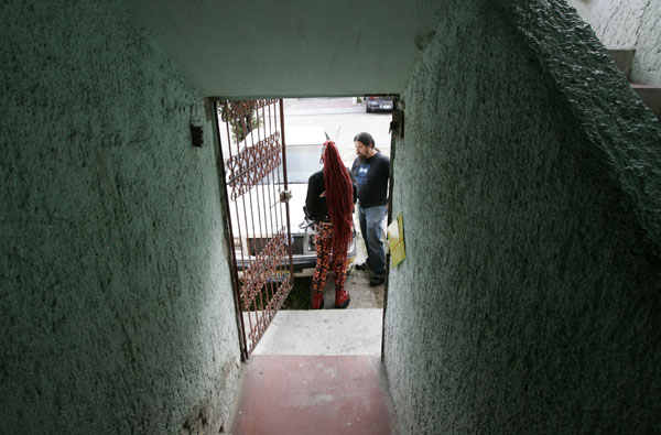 Maria Jose Cristerna stands outside a house with her partner David Pena in Guadalajara
