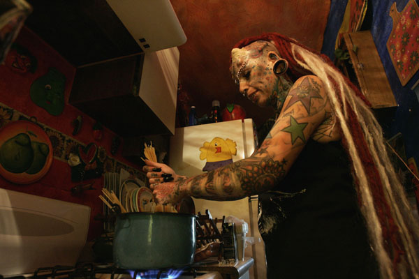 Maria Jose Cristerna, 36, a mother of four, tattoo artist and former laywer, prepares lunch for her family at her house in Guadalajara