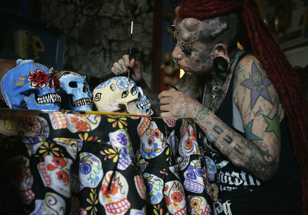 Maria Jose Cristerna, 36, a mother of four, tattoo artist and former lawyer, paints decorative skulls to be sold as art pieces at her home in Guadalajara
