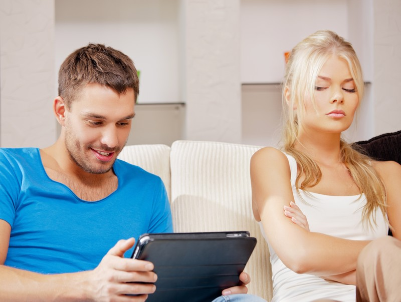 bright picture of couple with tablet